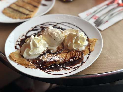 cream crepe with ice cream and syrup dessert