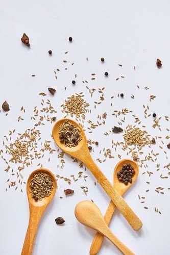 cutlery four brown spoons spoon