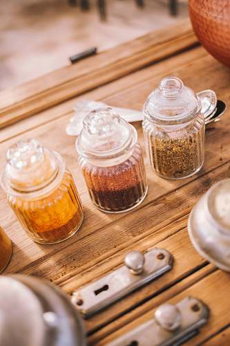 photo plant three glass jars with spices shelf free for commercial use images