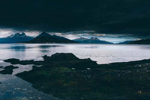 mountain landscape photography of mountain and body of water ushuaia