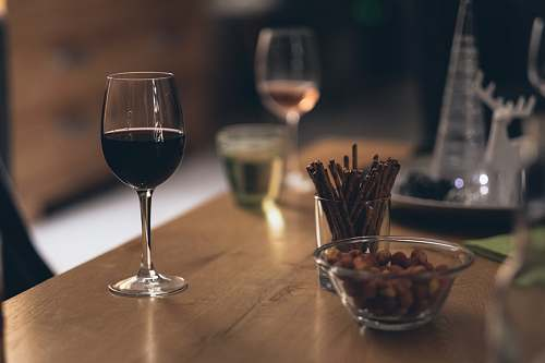 photo drink black liquid in clear wine glass on brown wooden table wine free for commercial use images