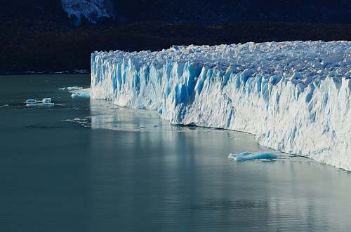 photo glacier ice cliff near on body of water outdoors free for commercial use images