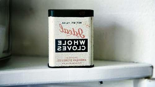 vintage Ideal Whole Cloves case on white shelf tin