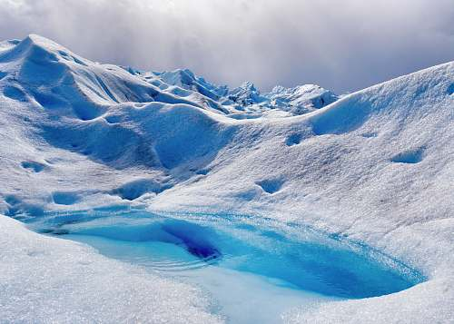 photo glacier lake in the middle of ice-covered mountain during daytime snow free for commercial use images
