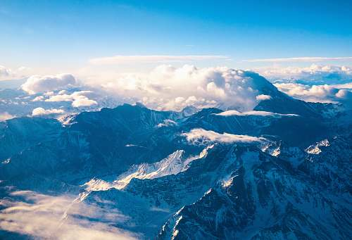 mountain mountain ranges covered in clouds snow