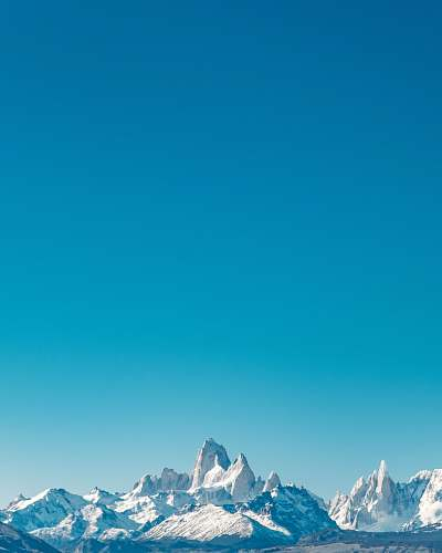 photo outdoors snow capped mountain range mountain free for commercial use images