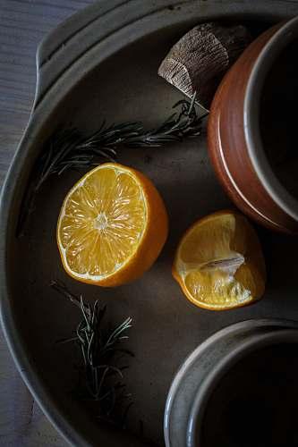 segment photo of sliced orange fruit on tray fruit