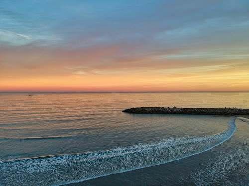 nature golden hour photography of body of water ocean