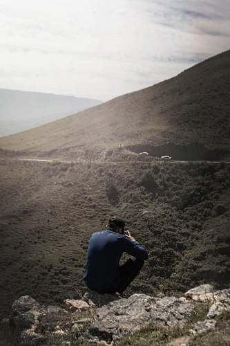 photo argentina man sitting on mountain human free for commercial use images