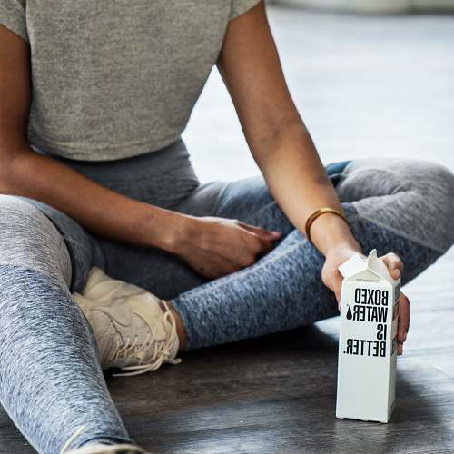 photo human woman sitting on floor holding carton box apparel free for commercial use images
