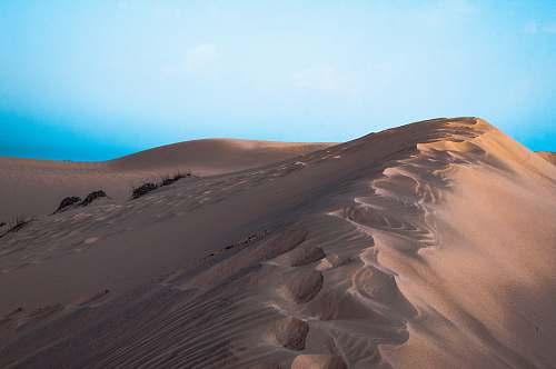 nature desert dunes photo during daytime outdoors