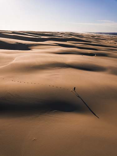 nature person walking on the desert photography sand