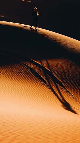 nature woman walking on desert sand