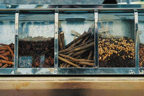 anise focus photography of assorted spices on display counter flavor