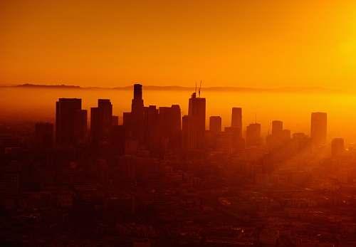 city silhouette photo of city skyline dawn