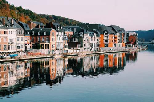canal assorted-color of houses near lake dinant