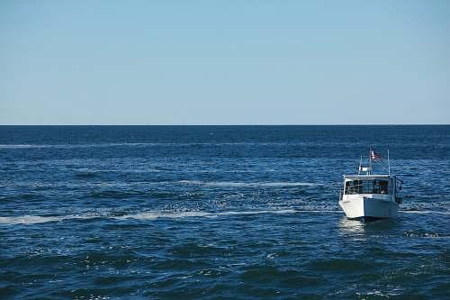 sea white motorboat at water ocean