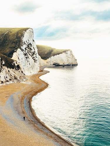 beach rock formation mountain near sear cliff