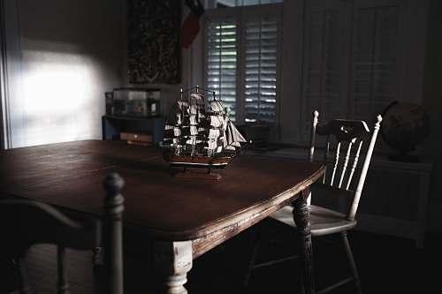ship ship miniature on table chair