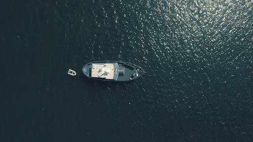 boat aerial photography of sailing boat in water water