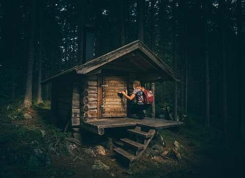 home girl knocking on wooden door hike