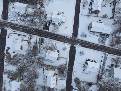 winter top view photography of house covered with snow house