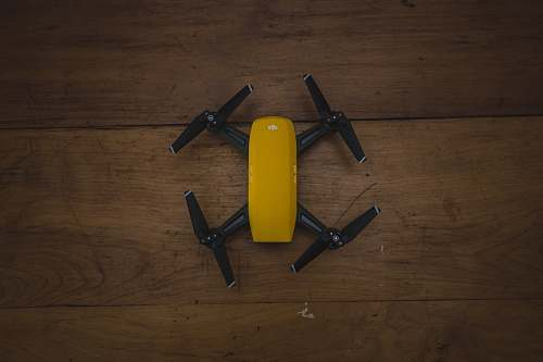 plywood yellow and black drone on wooden surface small