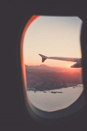 travel person riding airplane photography sunset