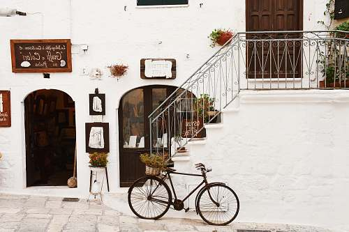 street black bicycle near handrails at daytime bike
