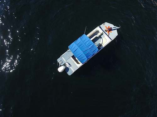 dinghy aerial photo of gray boat on body of water transportation