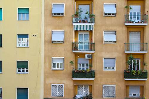 photo balcony yellow high-rise building rome free for commercial use images