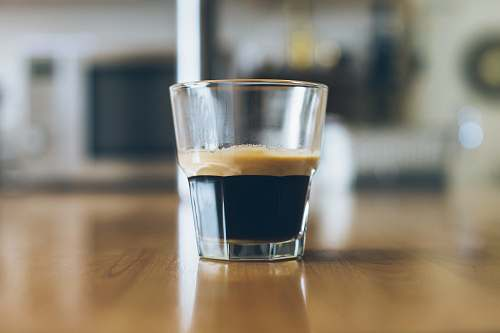 coffee clear shot glass on wooden table beverage