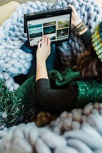 computer woman using black Samsung tablet computer tablet computer