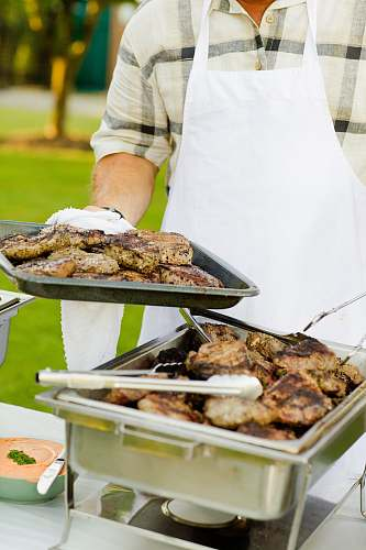 photo person person holding tray filled with grilled meat meal free for commercial use images