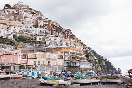 positano assorted sail boats on seashore during daytime villa