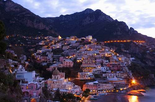 photo city houses beside sea with mountain background positano free for commercial use images