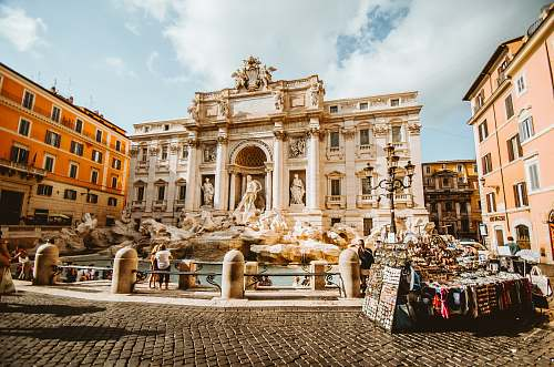 architecture man standing in front of statue rome