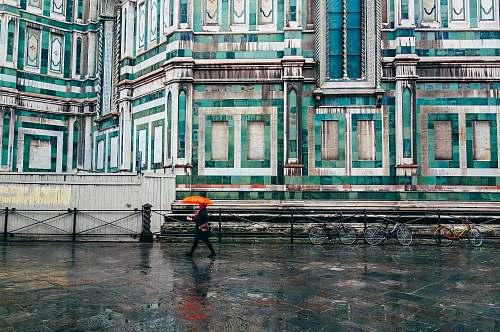 florence person holding umbrella walking on road rain