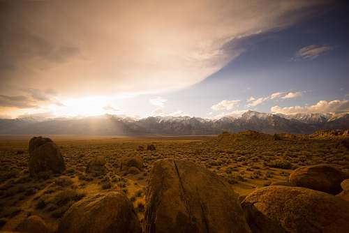 photo landscape brown desert under cloudy sky mountains free for commercial use images
