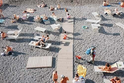 beach people on gray sand beach summer
