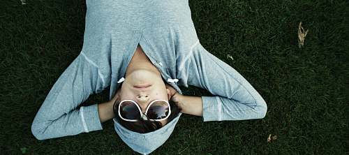people man lying on grass sunglasses
