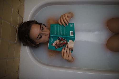 photo bathtub woman lying on bathtub with green book tub free for commercial use images