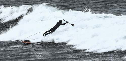 photo surfing man riding surfboard ocean free for commercial use images
