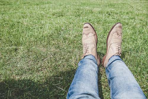photo shoes person wearing blue jeans and pair of white shoes footwear free for commercial use images