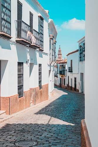 carmona empty street between houses cobblestone