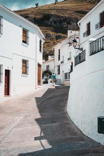 white man walking near houses street
