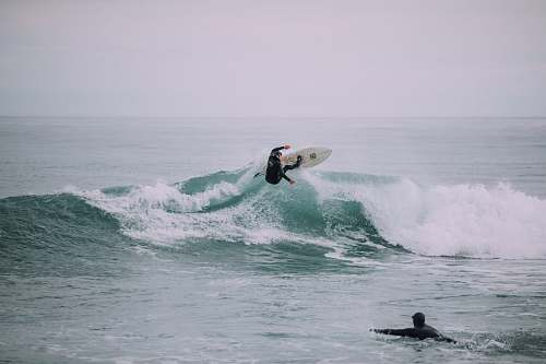 photo grey person surfing on waves sport free for commercial use images