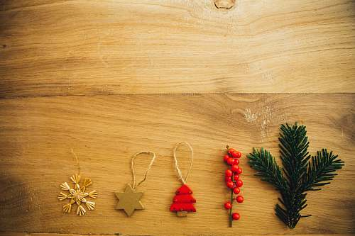 christmas five assorted Christmas tree decors on brown wooden surface foliage