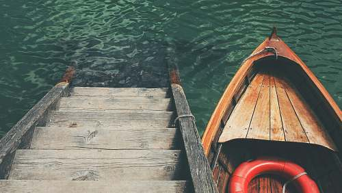 italy boat near wooden stairs boat