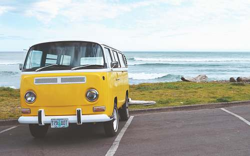 photo van yellow Volkswagen T2 van on concrete road seaside free for commercial use images